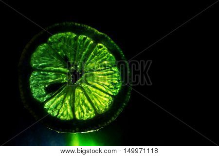 A light painting of a lemon in a darken background