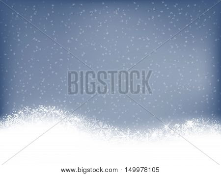 Christmas card.White border made of snowflakes on soft blue background with falling snowflakes and space for text.