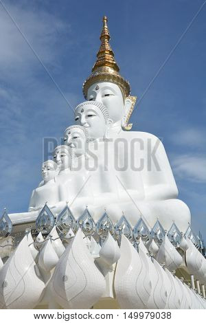 Five sitting Buddhas statue on blue sky is a Buddhist monastery and temple in Phetchabun Thailand. They are public domain or treasure of Buddhism no restrict in copy or use