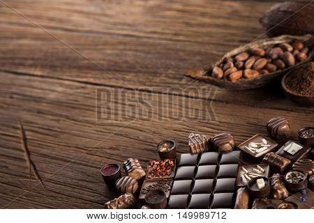 Praline Chocolate on wooden backgroud