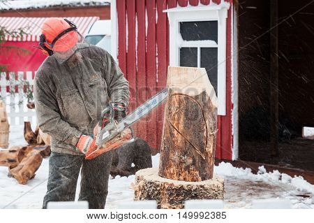 Finnish Sculptor With A Chainsaw