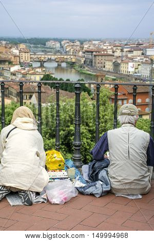 Two people on the viewpoint in Florence, Italy