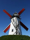 stock photo of damme  - Picture of a windmill with a clear blue sky at the background - JPG