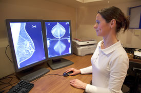 pic of mammography  - Female radiology technician examens mammography test on computer - JPG