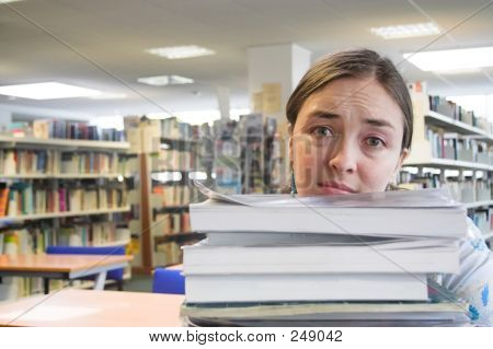 Female Student In A Library - Too Much Work