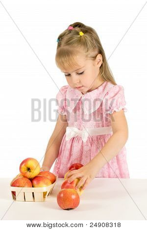 The little girl with the apples.