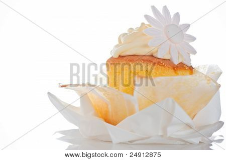 Cupcake With Vanilla Cream And Sugar Flower On A White Background