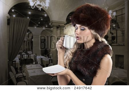 Beautiful Blonde Woman Drinking A Smoking Hot Cup Of Tea