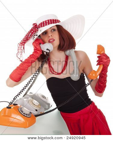 Fashion girl in retro style with vintage phones