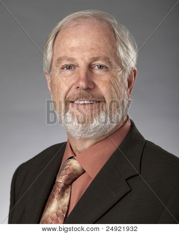Studio portrait of distinguished looking mature Caucasian man.