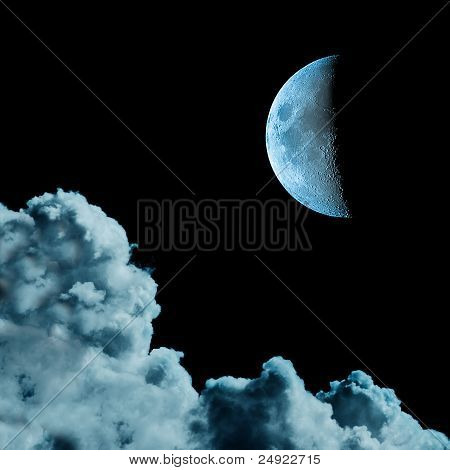 Cyanotype monotone image of moon and clouds