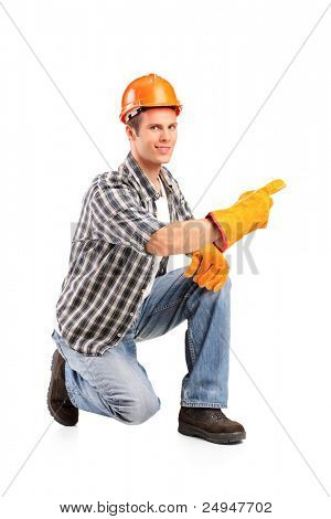 A confident and smiling worker posing isolated on white background