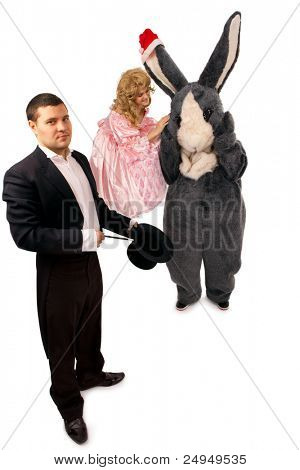 Performing magician with marionette and rabbit over white background