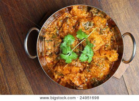 Indian chicken saag massala curry in balti dish.