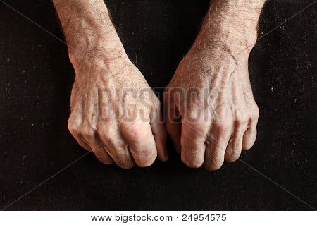 Clenched Fists Of Old Man