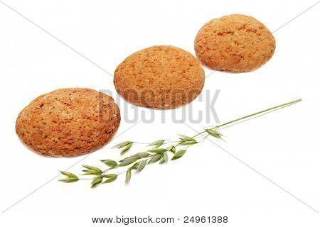 Three oatcakes and green panicle of oat.