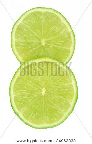 Two slices of lime isolated on white.