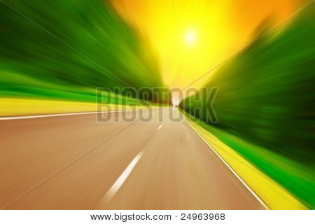 Road with motion blur and sun.