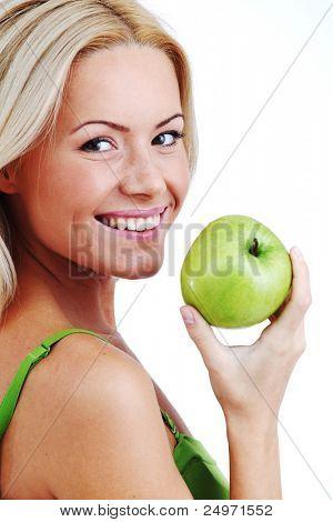 blond woman eat green apple on white