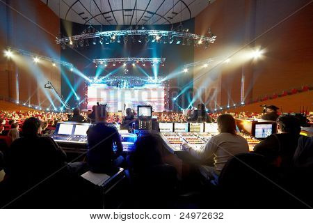 "MOSCOW - FEB 2: Operators at control panels at Second National Premium in field of digital television ""Big Digit"", Feb 2 2011, Moscow, Russia. Operators provide lighting, sound, recording during event"