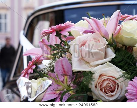 wedding bouquet on black car