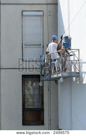 Workers Repairing Building
