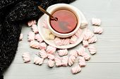Mug Filled With Black Brewed Tea, Spoon And Heap Of Marshmallow On White Wooden Background. Cup With poster