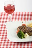 picture of chateaubriand  - delicious Tenderloin steak with red wine on a table - JPG