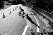 stock photo of landslide  - Driving around in the mountains of Taiwan you have to watch out for landslide damaged roads - JPG