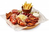 Big Barbeque Plate With Meat, French Fries, Garnish And Spicy Sauce, Top View, Close-up, Selective F poster
