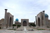 stock photo of mosk  - The three madrasahs of the Registan in Samarkand are - JPG