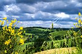 Cloudy Sky With Single Sunbeams Over Umbrian Fields And Meadows, Italy poster