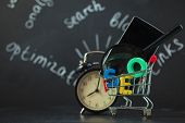Seo Search Engine Optimization Concept Colored Letters Of Seo With Clock, Magnifying Glass, Smartpho poster