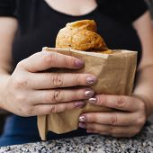 Snack On The Go, Junk Food, Coffee Break Concept. Young Woman Holding Fast Food Croissant, High-calo poster