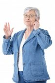 Mature woman chatting on mobile phone, smiling .?