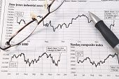 stock photo of bifocals  - Image of stock market reports with pen and glasses - JPG