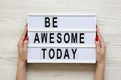 Female Hands Hold Modern Board With  Be Awesome Today Word. Top View, Flat-lay, Overhead. poster