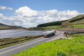 stock photo of fuel tanker  - Fuel tanker a long the road - JPG