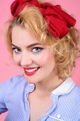 Close Up Portrait Of Pin Up Woman. Pin-up Clothes. Portrait Of Beautiful Blond Pin Up Girl With Red  poster