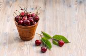 Fresh Cherry In A Ceramic Bucket On A Wooden Background. Fresh Ripe Cherry. Cherries. poster