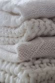 Background With Warm Sweaters. Pile Of Knitted Clothes In Warm Shades, Warm Background, Knitwear, Sp poster