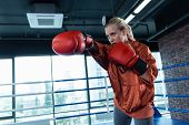 Sport Activity. Blonde-haired Woman Enjoying Sport Activity Greatly While Boxing Actively In Gym poster