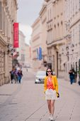 Happy Woman Walking In European Street. Young Attractive Tourist Outdoors In Vienna City On The Piaz poster