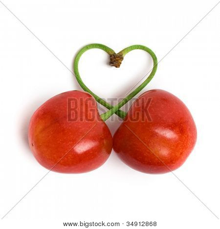 Heart chape from two cherries on a white background