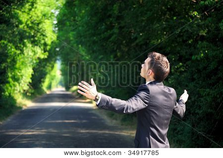 Business man pray on road