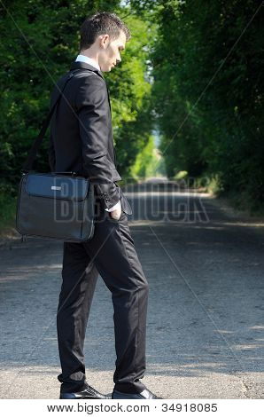 Business man unset on road