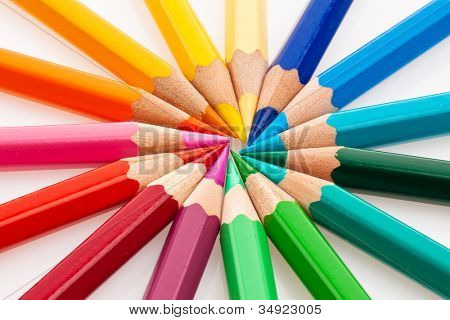 many different colored crayons on a white background.