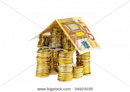 a house made of coins and banknotes. photo icon for house construction and home loans