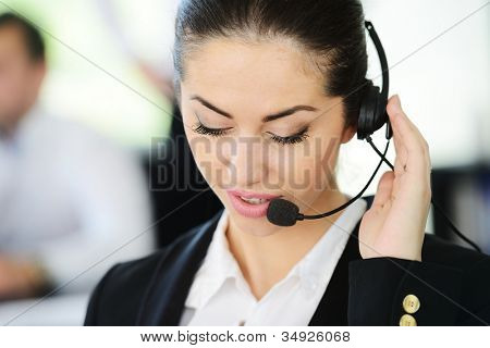 Beautiful support girl in calling centre