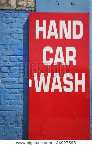 Bright Red Hand Car Wash Sign